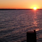 Den Sonnenuntergang am Meer fotografieren